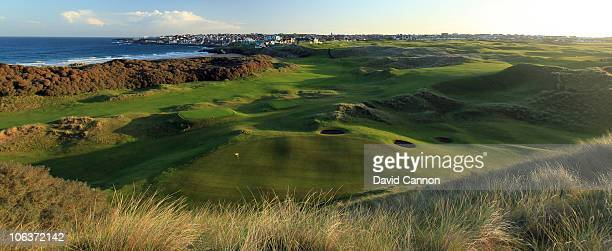 A view looking down on the green on the 427 yards par 4 8th hole 'Portnahapple' back accross the 1st fairway towards the clubhouse on the hill on the...