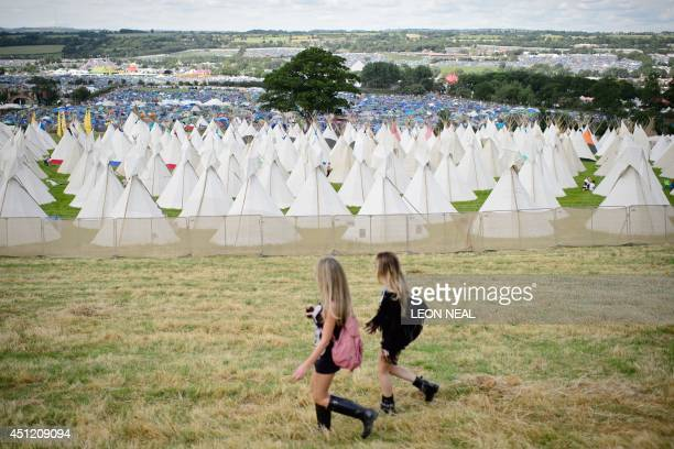 View looking down on the tipi field as the gates open at the Glastonbury Festival of Music and Performing Arts in Somerset, southwest England, on...