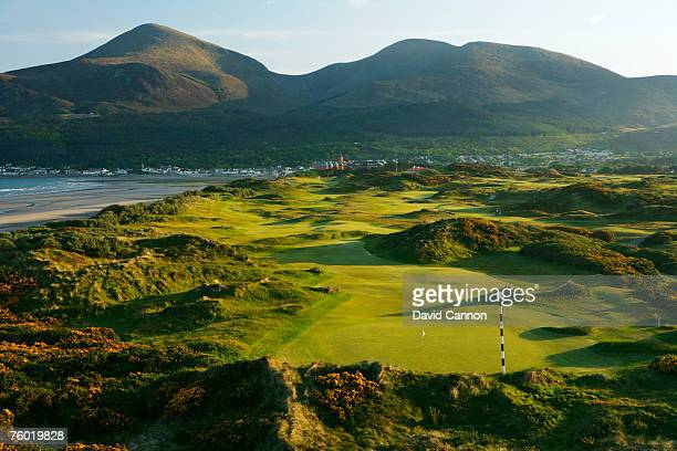 IRELAND MAY 21 A view looking down over the 477 yards par 4 3rd hole and the rest of the links towards the town of Newcastle and the Mourne Mountains...