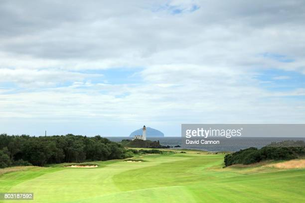 A view looking down the fairway of the par 5 12th hole with the Turnberry Lighthouse and the island of Ailsa Craig behind on the newly opened King...