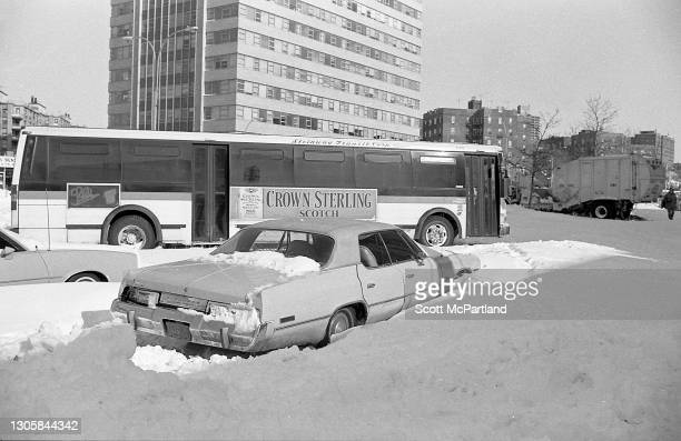 View, looking east, along Queens Boulevard of a stranded car, city bus, and other vehicles, in the aftermath of a blizzard, in the Rego Park...