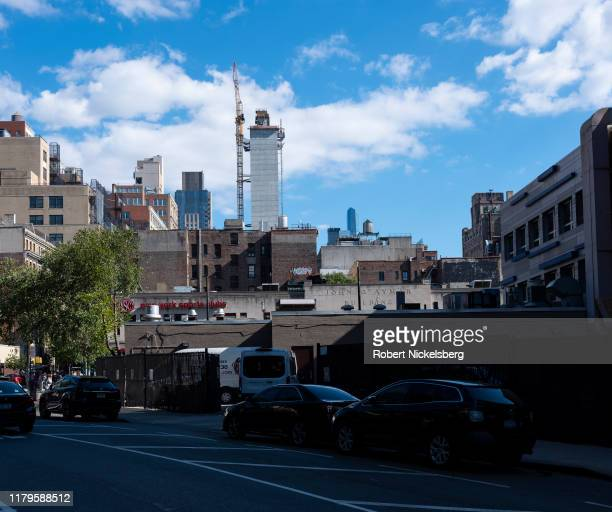 View looking east shows a changing skyline across 8th Avenue at 24th Street in New York City on October 5, 2019. At the street-level center of the...