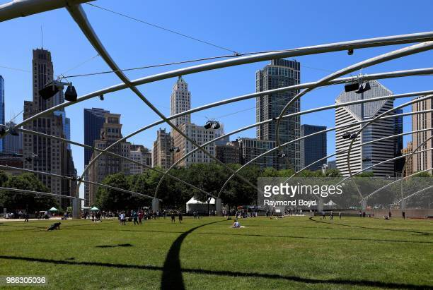 View looking into Downtown Chicago as photographed from The Great Lawn under architect Frank Gehry's Jay Pritzker Pavilion in Millennium Park in...