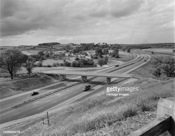 View looking north along Section C of the recently completed Birmingham to Preston Motorway near Trentham Park, showing the access bridge to Trentham...