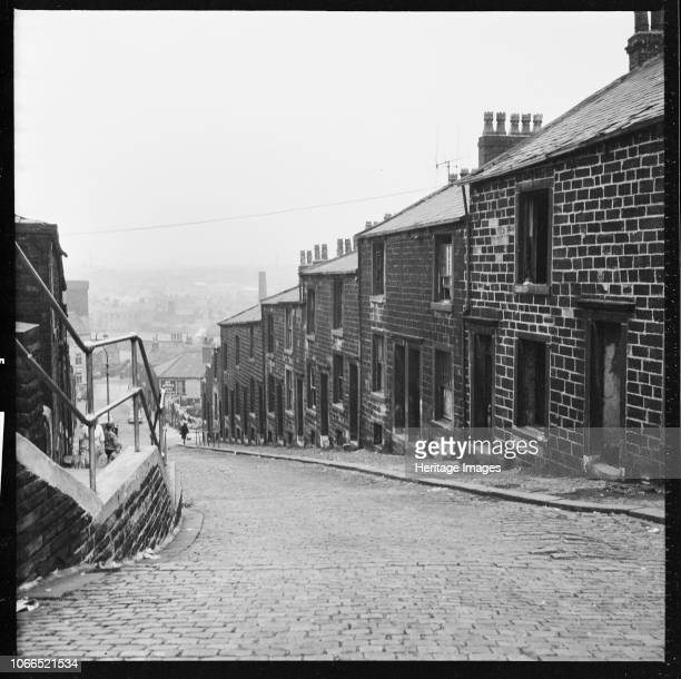 Healey Wood Road Burnley Lancashire circa 1966 circa 1974 View looking north along the road from the railway line showing abandoned houses awaiting...