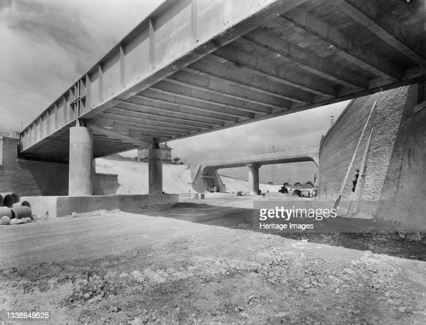 View looking north at a section of the London to Yorkshire Motorway in Luton, showing the Luton-Dunstable railway bridge in the foreground and...