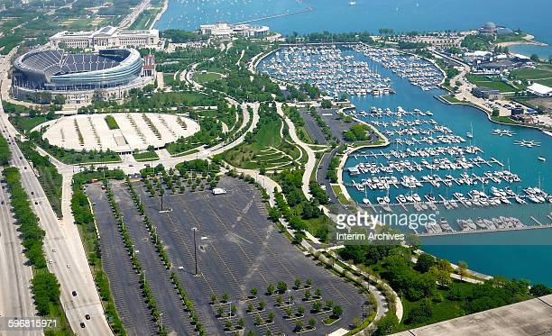 View, looking north at the Museum Campus with the Field Museum, Soldier Field, and the Shedd Aquarium in the upper left, and the Adler Planetarium in...