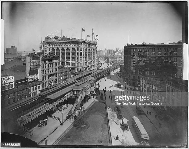 View looking north up Broadway from around 32nd Street showing Herald Square Saks and the elevated railroad station New York New York 1895