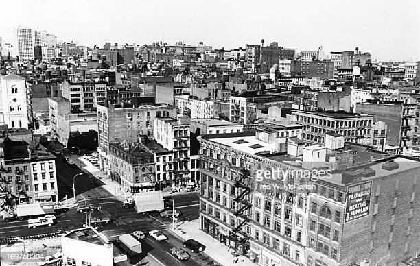View, looking northeast across the rooftops of Soho, New York, New York, 1978. The view shows the interection of Canal Street and West Broadway.