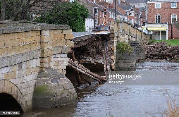 A view looking over the collapsed bridge over the River Wharfe that collapsed due to flooding on December 30 2015 in Tadcaster England Heavy rain...