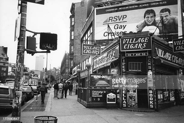 View looking south along 7th Avenue New York New York October 31 1991 Visible is the Christopher Street subway station and Village Cigars above with...