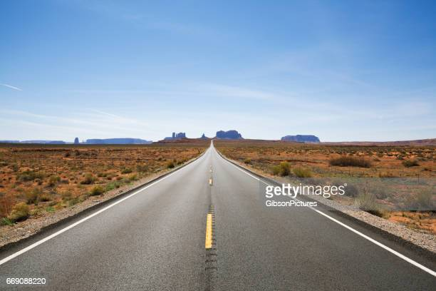 A view looking south at Highway 163 and Monument Valley in Utah, USA.