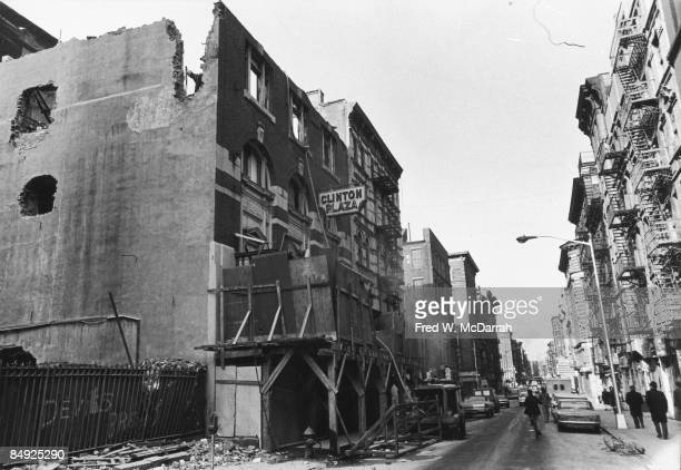 View looking south on Clinton Street past the partially demolished Clinton Plaza New York New York February 6 1966 The marquee of the Apollo Theater...