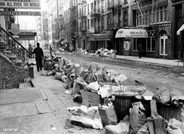 View looking southwest of trash and snow piled along the sidewalk of MacDougal Street in Greenwich Village New York New York February 15 1969...