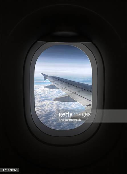 view looking through an airplane window - porthole stock photos and pictures