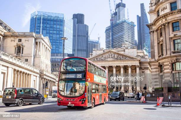 view looking towards threadneedle st where the the bank of england is situated. the modern architecture in the background contrasting with the older georgian architecture - bank of england stock photos and pictures