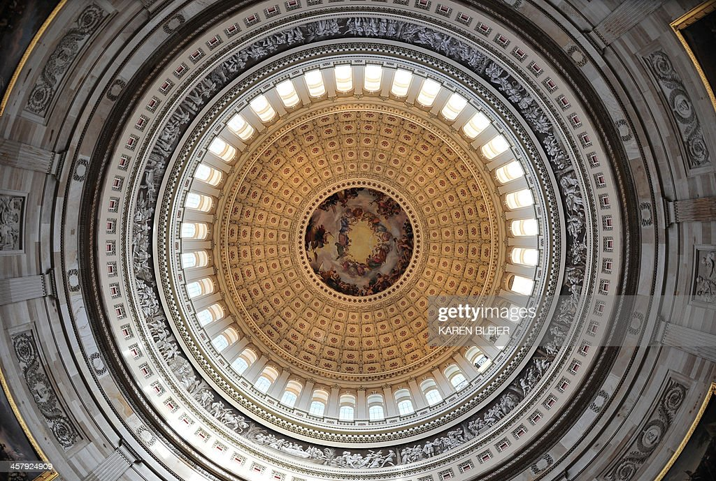 A view looking up from the Rotunda of the US Capitol before a tour of the dome December 19, 2013 in Washington, DC. The Dome has not undergone a complete restoration since 1959-1960 and due to age and weather is now plagued by more than 1,000 cracks and deficiencies. The Architect of the Capitol began in November, a multi-year project to repair these deficiencies, restoring the Dome to its original, inspiring splendor. AFP PHOTO / Karen BLEIER