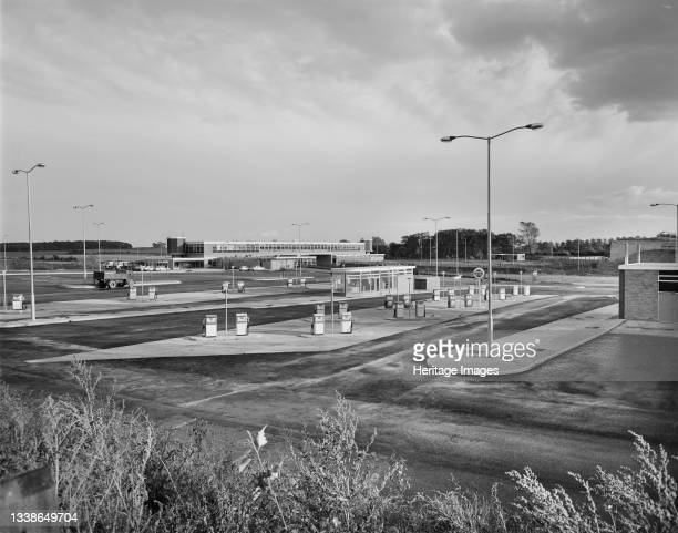 View looking west across the Keele Service Area on the Birmingham to Preston Motorway , showing its petrol station and pumps in the foreground with...