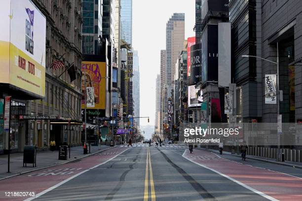 A view looking west along an empty 42nd Street near Times Square amid the coronavirus pandemic on April 12 2020 in New York City United States...