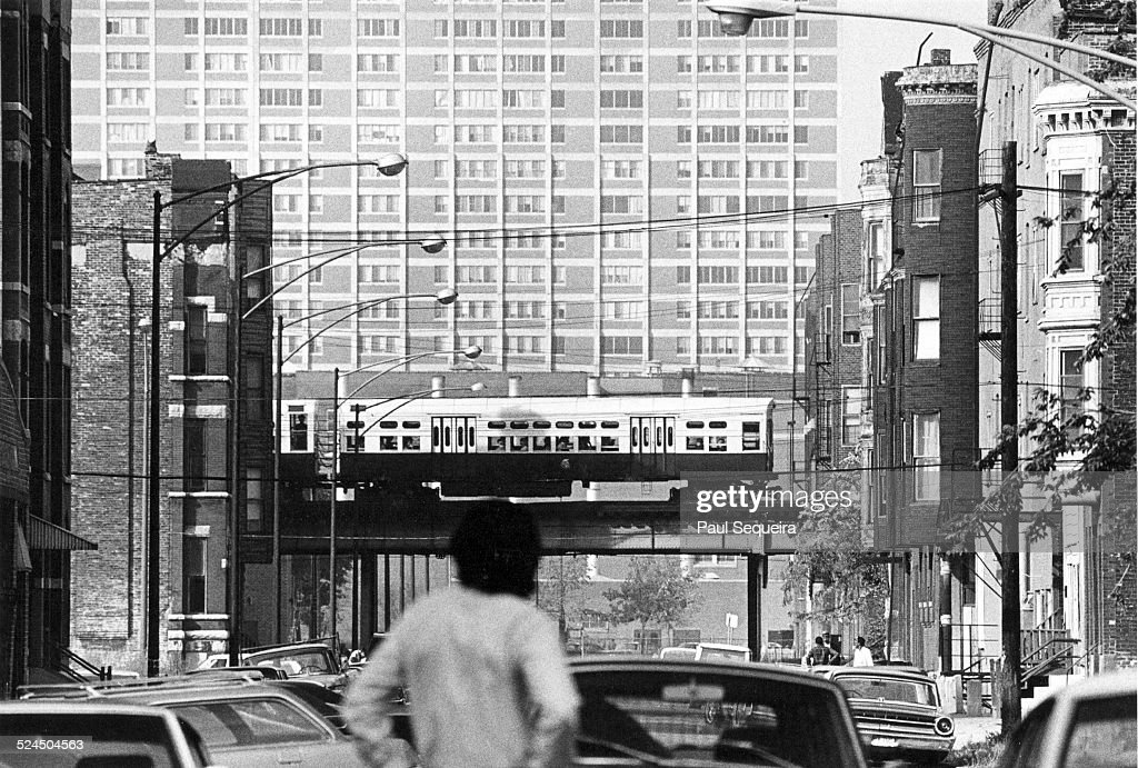 View looking west at the Cabrini Green housing projects, from LaSalle Street, Chicago, Illinois, 1960s. A Chicago elevated train is visible in the middle distance.
