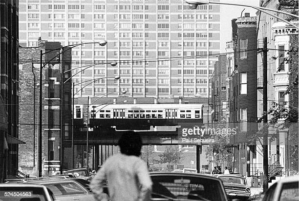 View looking west at the Cabrini Green housing projects from LaSalle Street Chicago Illinois 1960s A Chicago elevated train is visible in the middle...