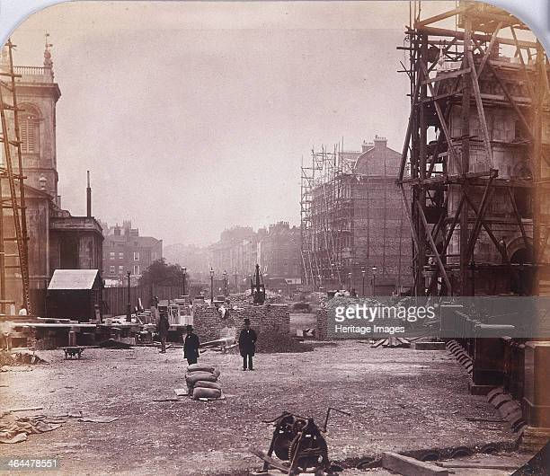 View looking west of Holborn Viaduct under construction Holborn London 1869 One of the four step buildings designed to provide stairway access...
