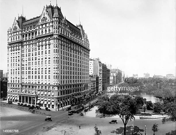 View looking west on 59th street of the east and north facades of the Plaza Hotel early twentieth century The southern end of Central Park with...