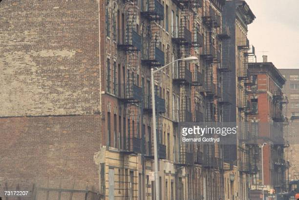 View looking west towards 1st Avenue in East Harlem, New York, New York, late 1970s.