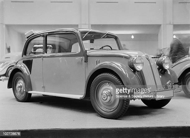 View Mercedes Benz car at Berlin Exhibition. Photograph taken during Berlin Automobile Exhibition, 1935.
