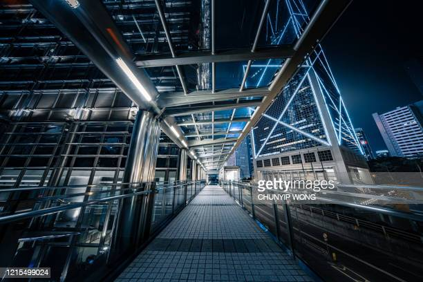 view night downtown cityscape of hong kong from skywalk - elevated walkway stock pictures, royalty-free photos & images