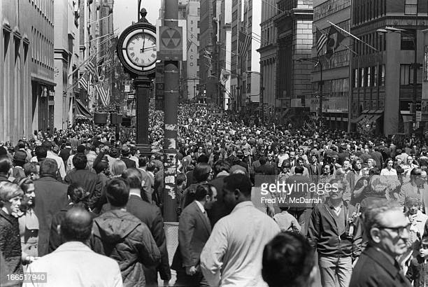 View north along 5th Avenue as thousands of people on the street in celebration of Earth Day New York New York April 22 1970