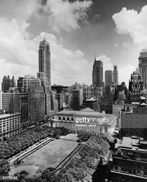 View northeast across Bryant Park designed by architect Thomas Hastings New York New York 1940s In the center bordering on the park is the New York...