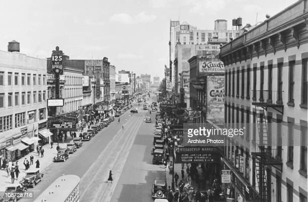 A view of 125th Street looking east from 8th Avenue Harlem New York City circa 1935