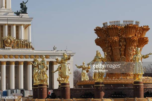 A view of 16 gilded bronze sculptures of women depicting 16 republics of the USSR after the reconstruction of the Druzhba Narodov fountain at the...