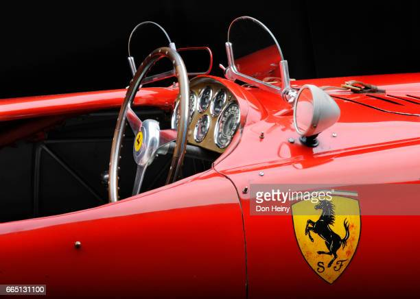 view of 1953 ferrari 375 mm into cockpit showing steering wheel, wind screen - ferrari stock pictures, royalty-free photos & images