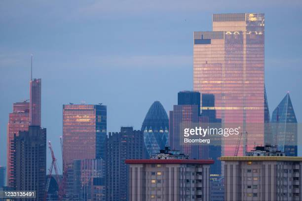 View of 30 St. Marys Axe, also known as The Gherkin, on the City of London, U.K., on Wednesday, May 26, 2021. A supermoon is when a full moon occurs...