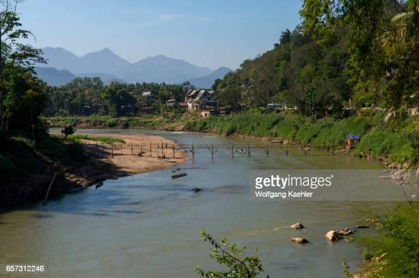 View of a bamboo bridge over the Nam Khan River in Luang Prabang in Central Laos