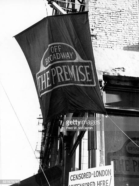 View of a banner for Theodore Flicker's offBroadway improvisational theatre group the Premise on the corner of Bleeker and Thompson streets New York...