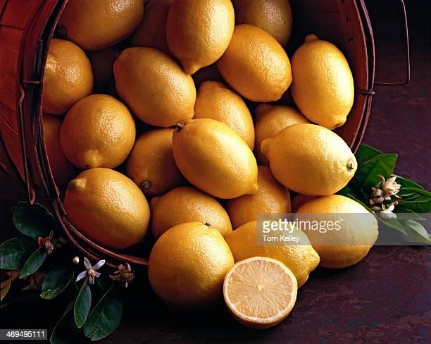 View of a basket of lemons with one lemon cut in half 2010