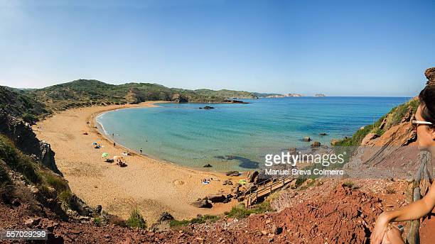 view of a beach in menorca - women skinny dipping stock pictures, royalty-free photos & images