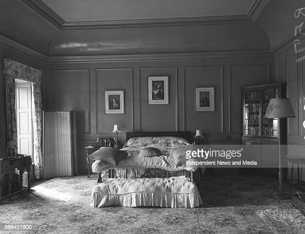 View of a bedroom with a cabinet of books at Gloster Castle Brosna County Offaly Ireland March 13 1954