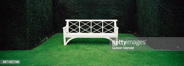 A view of a bench set within neat hedges at Sandringham House the muchloved country retreat of Her Majesty the Queen It has been the private home of...