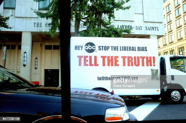 View of a billboard van in traffic on Columbus Avenue outside the Church of Jesus Christ of Latterday Saints' Manhattan New York Temple New York New...