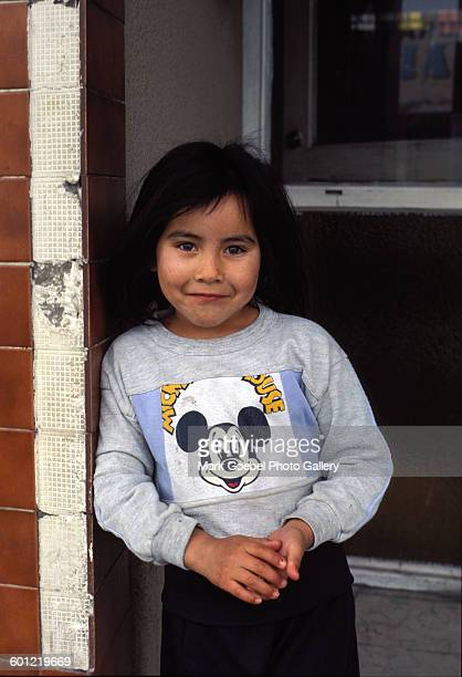View of a blackhaired girl in a Mickey Mouse tshirt as she smiles Juarez Mexico late 1980s