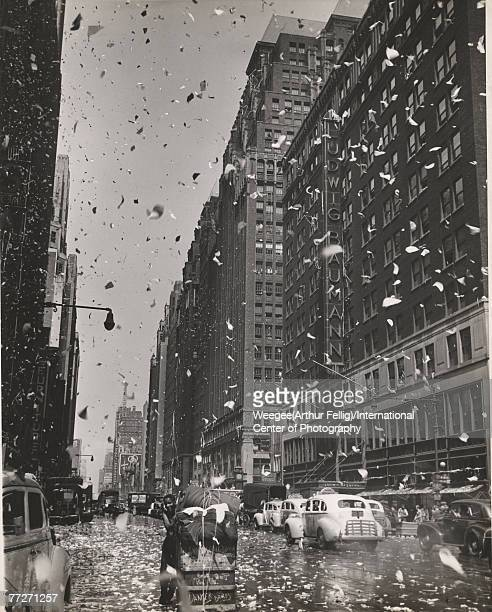 View of a blizzard of paper on 8th Ave at 35th St in Manhattan's garment center New York New York August 10 1945 The impromptu celebration was held...
