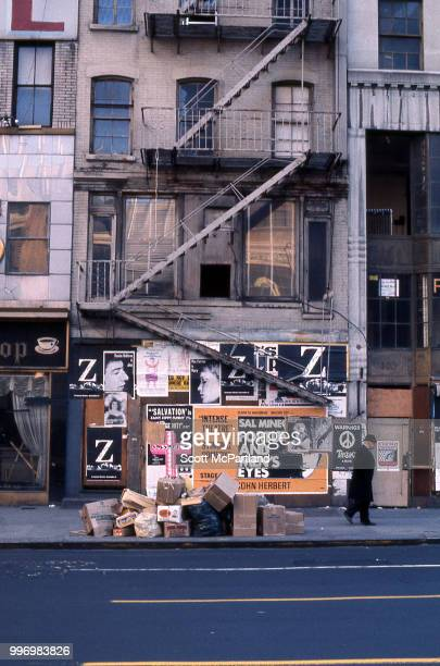 View of a boardedup apartment building on Manhattan's Lower East Side New York New York September 1 1970 Cardboard boxes and trash is piled on the...