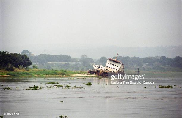 View of a boat wrecked and decayed on the shore of the Congo River near Kinshasa Democratic Republic of the Congo 2003 Photo taken during the...