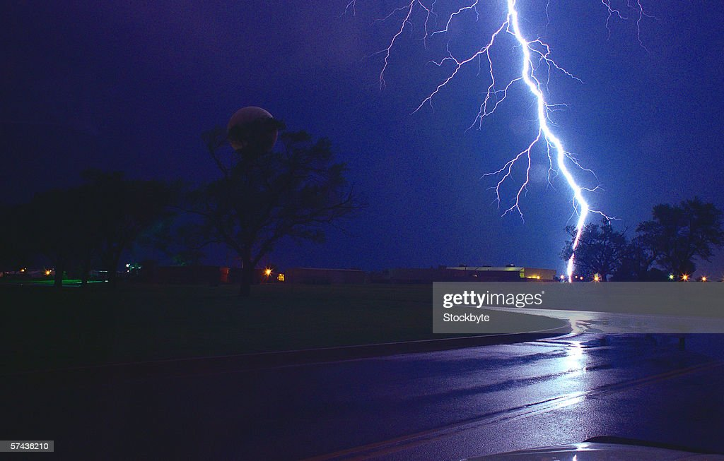 view of a bolt of lightning hitting the ground : Stock Photo