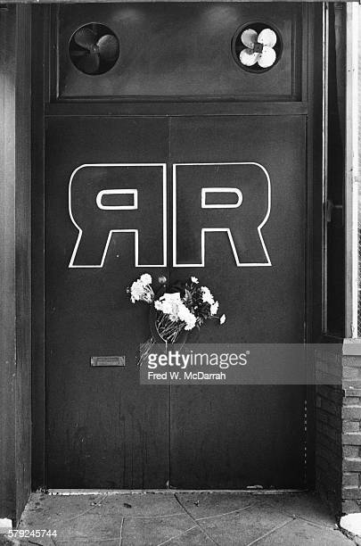 View of a bouquet of flowers through the closed door handles of the Ramrod bar New York New York November 20 November 20 1980 The previous day the...