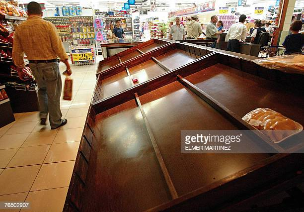 View of a bread empty gondola in the supermarket as people stock up with food previous to the arrival of Hurricane Felix in Tegucigalpa 04 September...